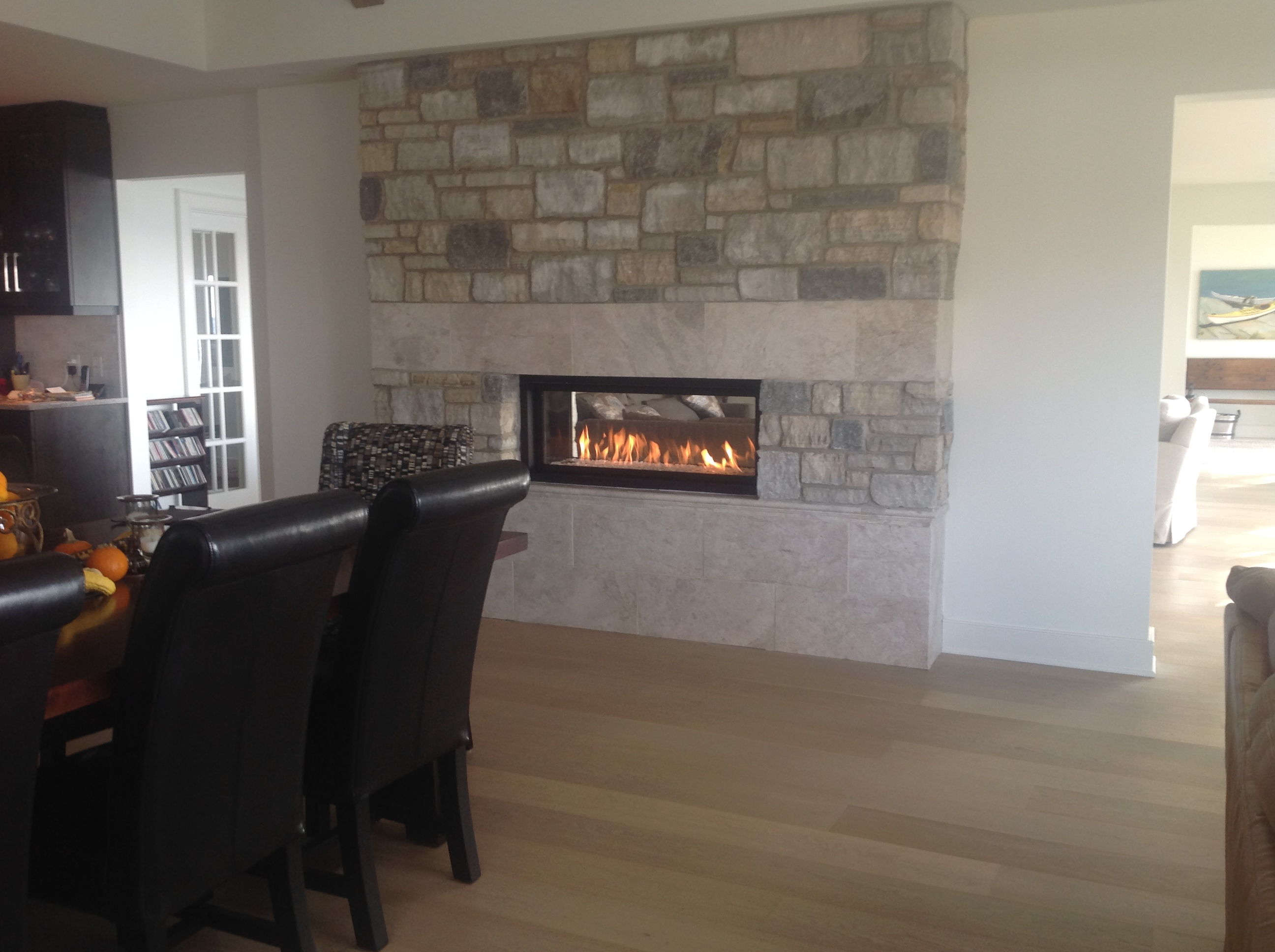 Linear-See-through-fireplace-with-real-stone-facing